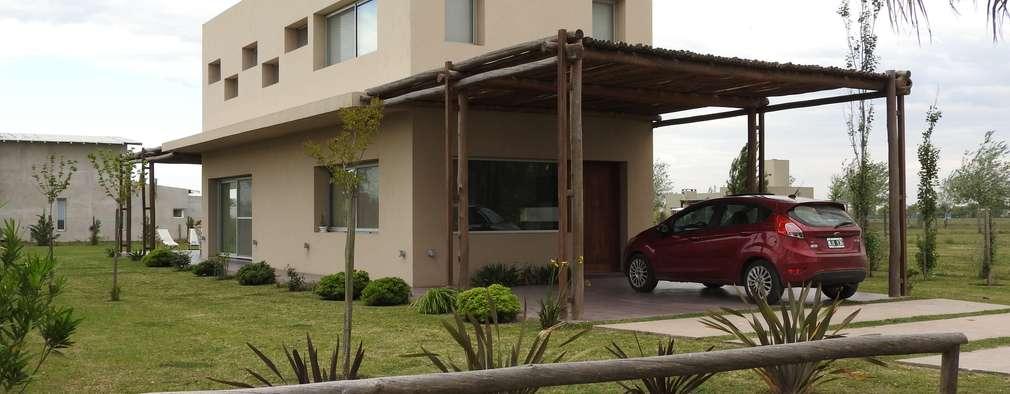 Casas de estilo moderno por Erb Santiago