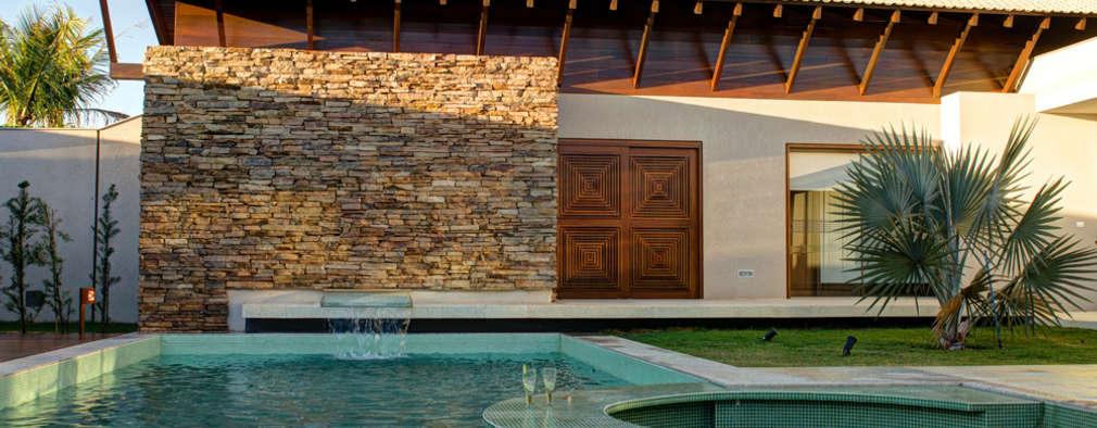 modern Pool by BRAVIM ◘ RICCI ARQUITETURA