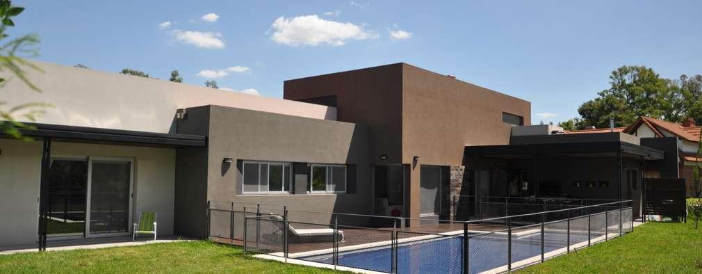 Casas de estilo minimalista por Estudio Fernández+Mego