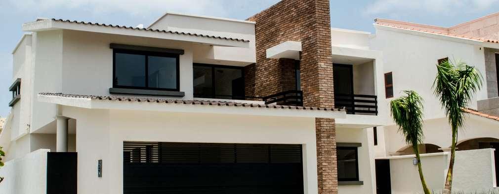 Casas de estilo moderno por ARKOT arquitectura + construcción