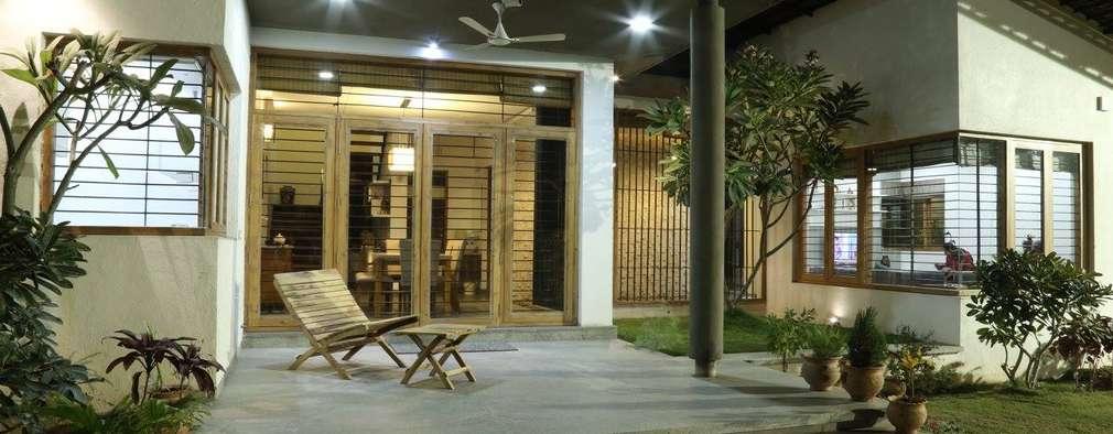 Terrazas de estilo  por 4th axis design studio