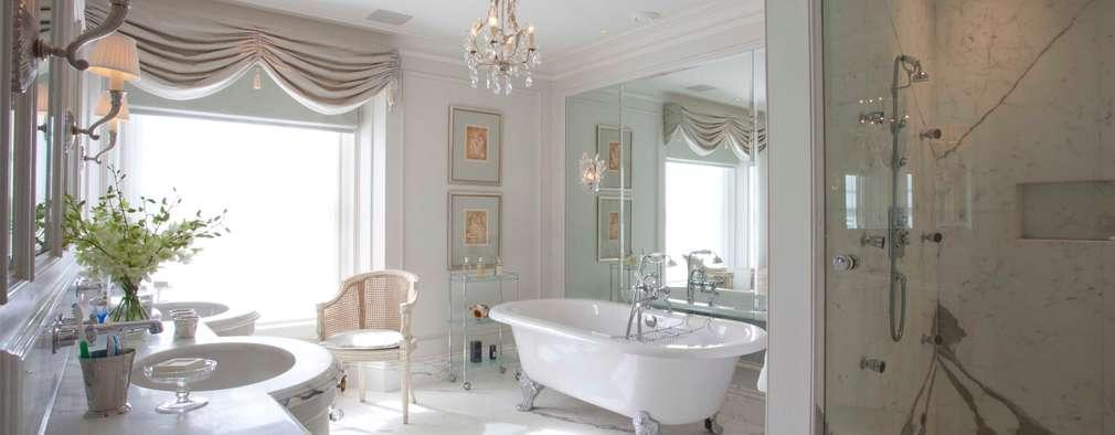 Baños de estilo clásico por Janine Stone Design