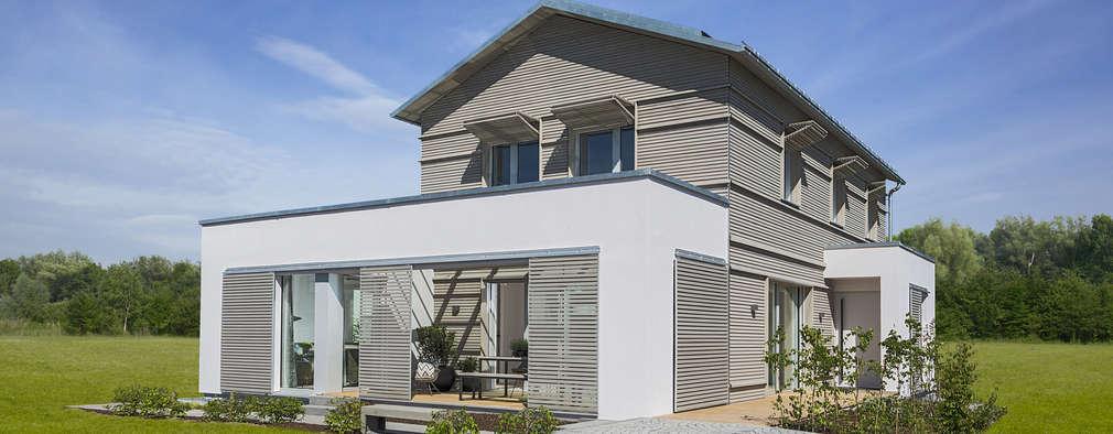 Projekty, nowoczesne Domy zaprojektowane przez Bau-Fritz GmbH & Co. KG
