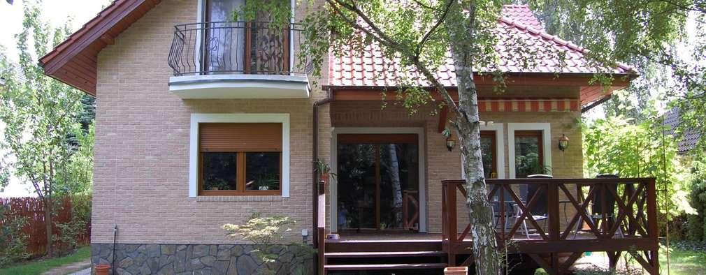 Casas de estilo rústico por ITA Poland s.c.
