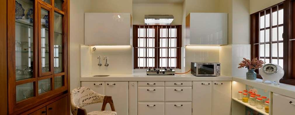 Cocinas de estilo moderno por Aum Architects