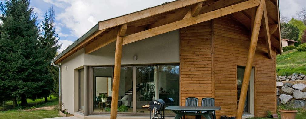 Casas de estilo ecléctico por Pierre Bernard Création