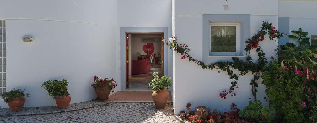 Projekty, klasyczne Domy zaprojektowane przez Zenaida Lima Fotografia