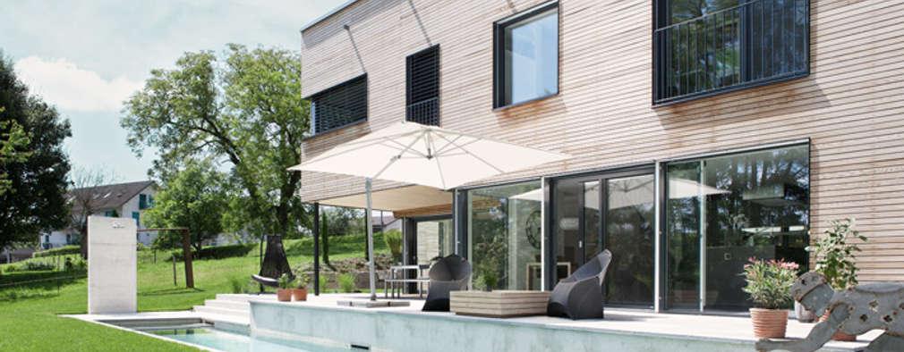 Villa Aus Holz Am Murtensee Moderner Pool Von Unica Architektur AG