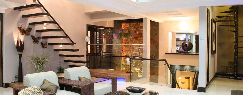 Salas de estilo tropical por Design Spirits