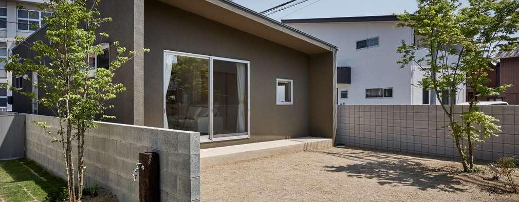 Casas de estilo minimalista por toki Architect design office