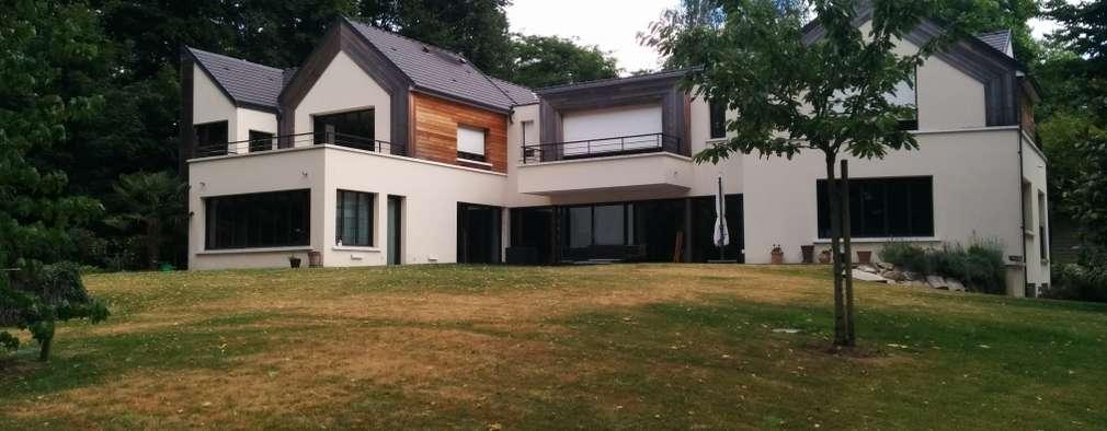 Réhabilitation moderne complète: Maisons de style de style Moderne par Archionline
