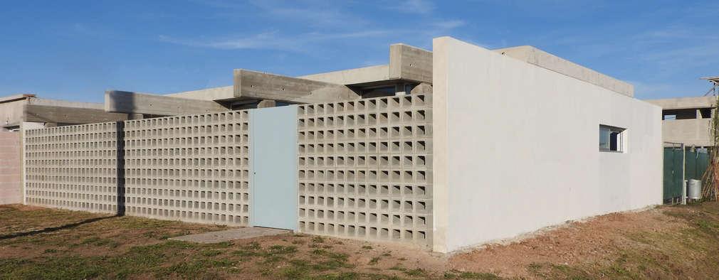VIVIENDA RR: Casas de estilo moderno por riverorolnyarquitectos