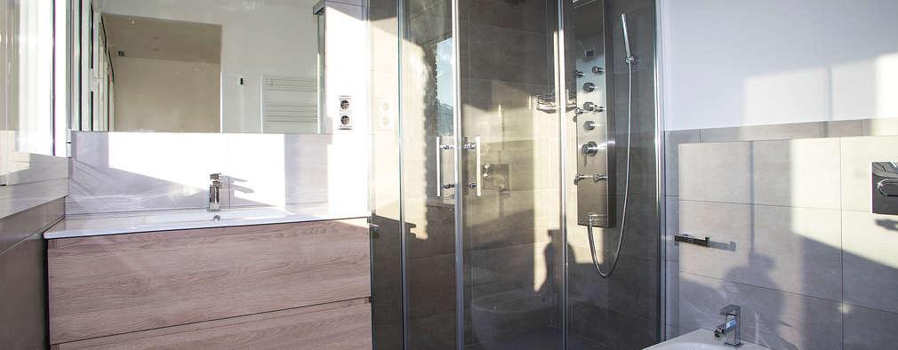 Baño suite: Baños de estilo moderno de Grupo Inventia