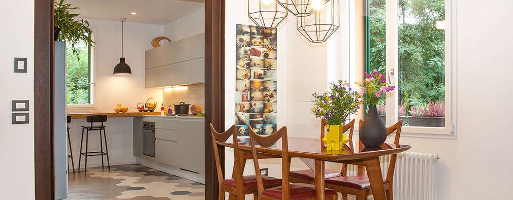 Salas de estilo moderno por senzanumerocivico
