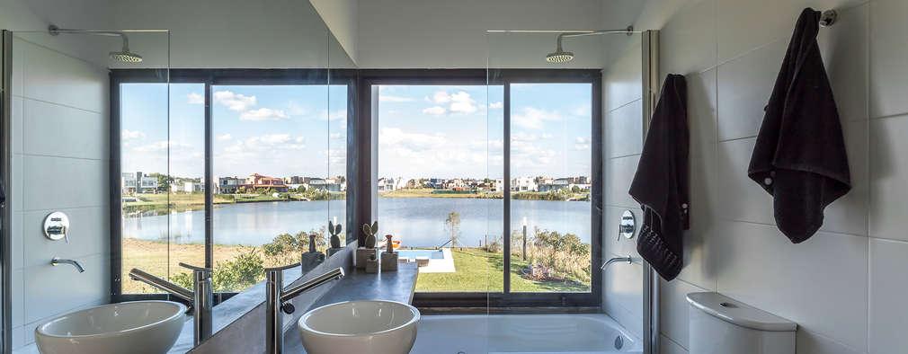 Casa San Benito: Baños de estilo moderno por Besonías Almeida arquitectos