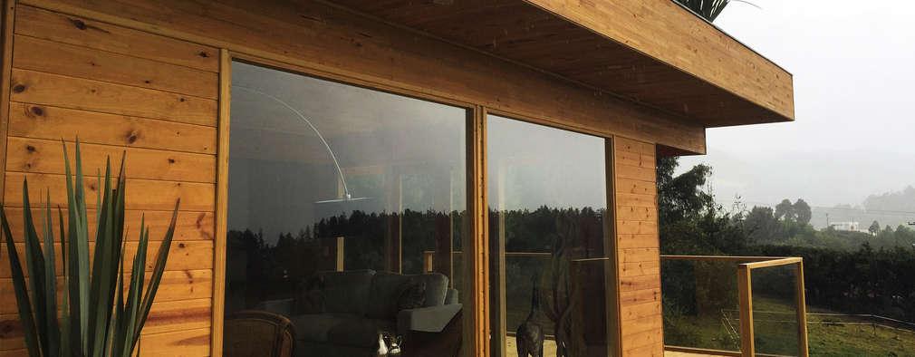 Unión de naturaleza y madera: Casas de estilo moderno por Taller de Ensamble SAS