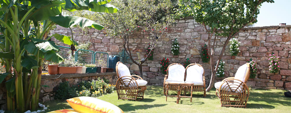 Jardins  por Aykuthall Architectural Interiors