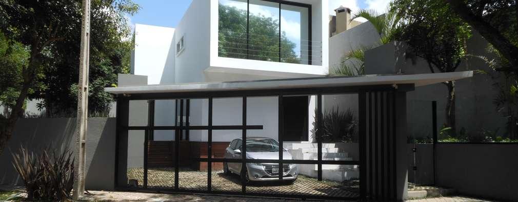 Casas de estilo moderno por Cláudia Legonde