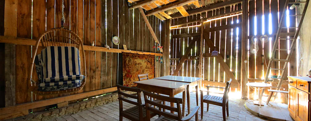 Comedores de estilo rural por 3rdskin architecture gmbh