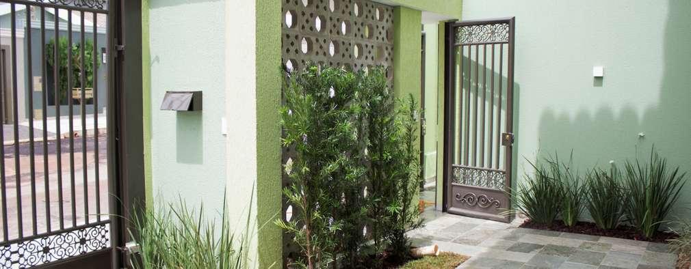 Garajes y galpones de estilo minimalista por Pz arquitetura e engenharia