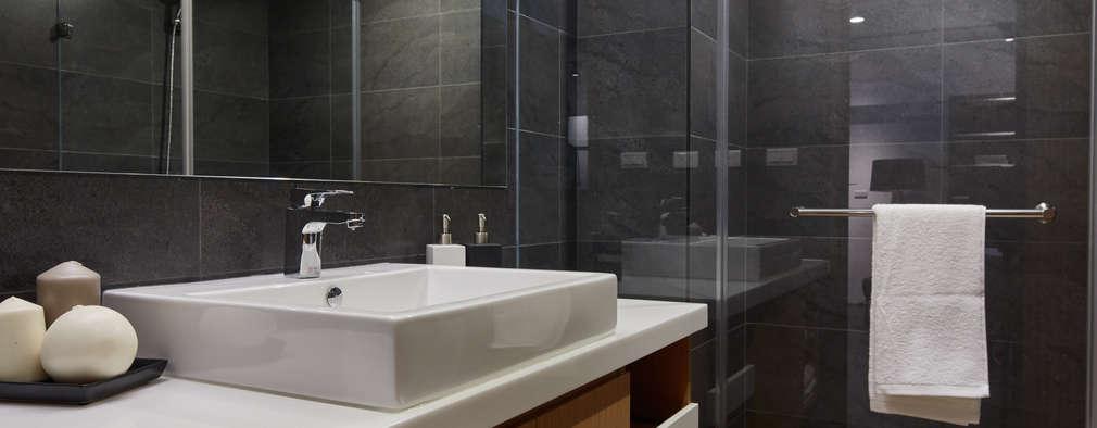 Baños de estilo industrial por 合觀設計