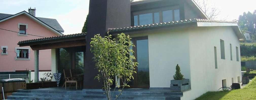 Casas de estilo clásico por Intra Arquitectos