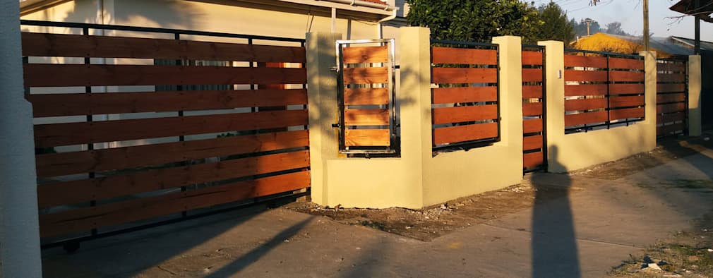 Cierre hormigon metal madera: Casas de estilo ecléctico por ARQUITECTURA E INGENIERIA PUNTAL LIMITADA