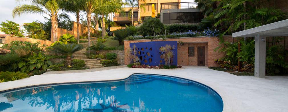 Casa 906: Piscinas de estilo moderno por Objetos DAC