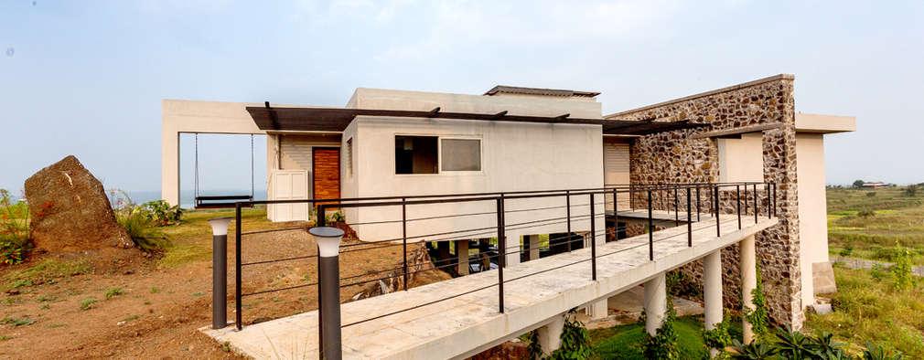 Casas de estilo rústico por Inscape Designers