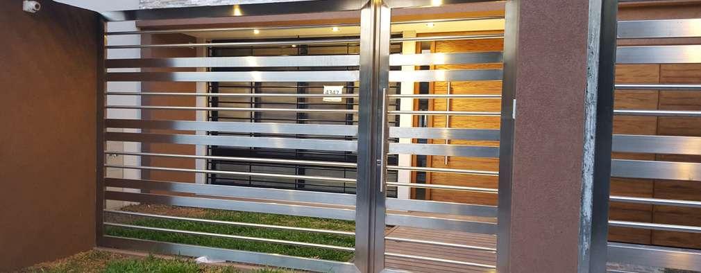 Casas de estilo moderno por Arquitecto Oscar Alvarez