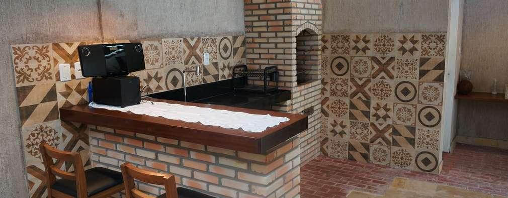 Garages de estilo rústico por Reinaldo Pampolha Arquitetura