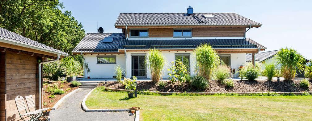 Projekty, klasyczne Domy zaprojektowane przez RO-REI Holzhaus GmbH & Co.KG