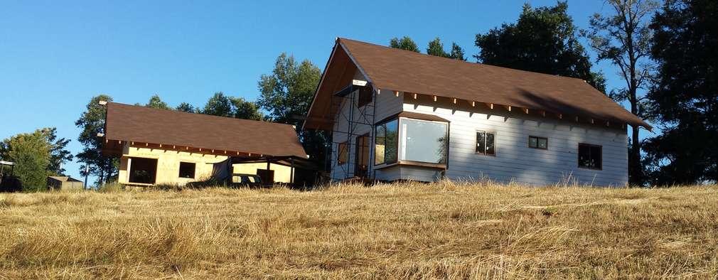Cabaña Ñancul: Casas de estilo rústico por Arquitectura y Construcción Chinquel