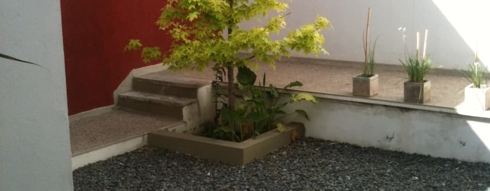 Edificio Soleares: Jardines de estilo moderno por Development Architectural group