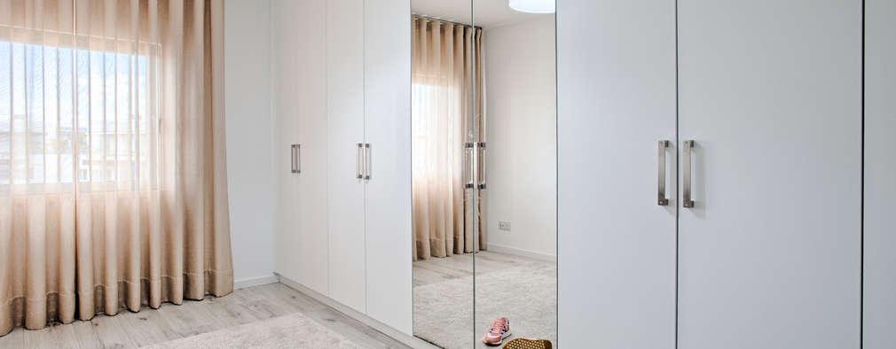 Closet: Closets modernos por menta, creative architecture