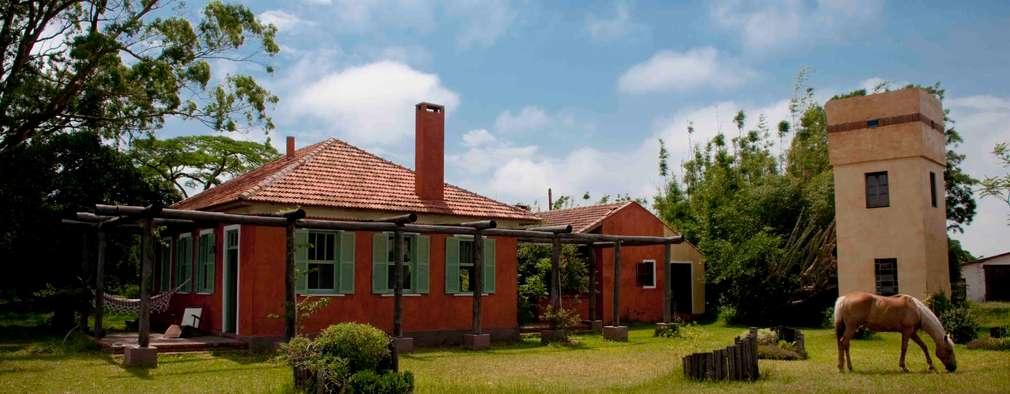 Fazenda Palmares - Ampliação: Casas campestres por CABRAL Arquitetos