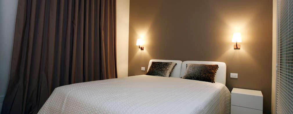 La camera padronale: Camera da letto in stile in stile Moderno di Daniela Nori