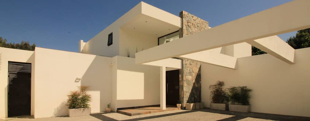 Casa B: Casas de estilo mediterraneo por Carvallo & Asociados Arquitectos