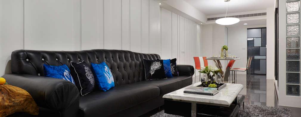 不同厚度與寬度的線條只為了增加空間順延伸的視覺感:  客廳 by 弘悅國際室內裝修有限公司