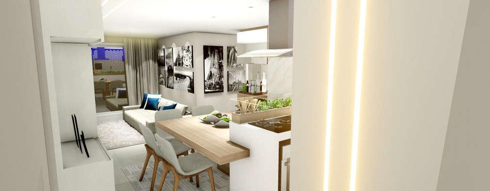 Apartamento compacto para jovem casal moderno: Salas de jantar modernas por Studio²