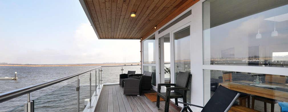 floating architecture - WKH 100 Terrasse: moderne Häuser von büro13 architekten