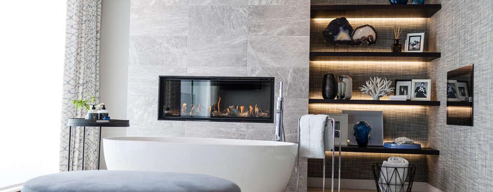 Elegante: Baños de estilo moderno por Claudia Luján