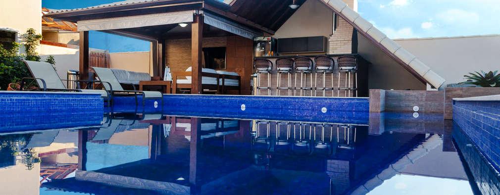 Piscina, Churrasqueira e Louge: Condomínios  por MORSCH WILKINSON arquitetura