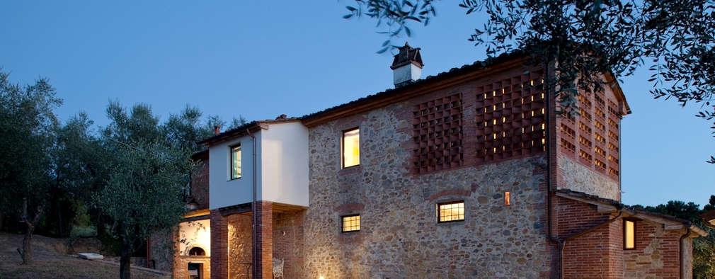 Projekty, rustykalne Domy zaprojektowane przez MIDE architetti