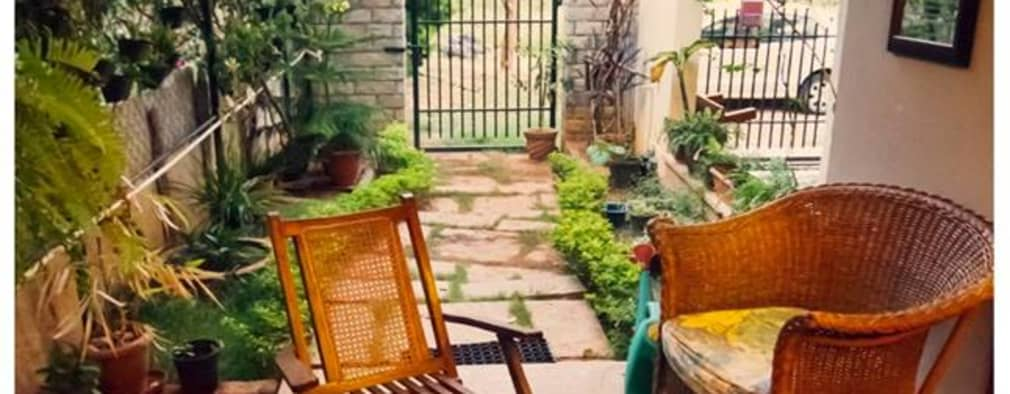 Saravan - The Singh's residence: eclectic Garden by Sandarbh