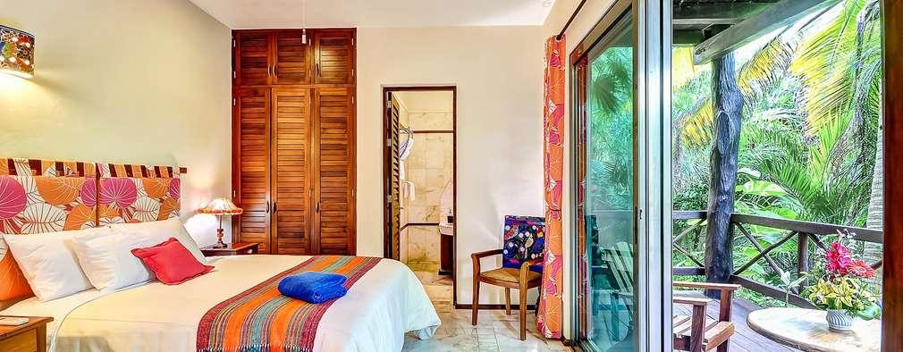 Habitaciones de estilo tropical por DHI Arquitectos y Constructores de la Riviera Maya