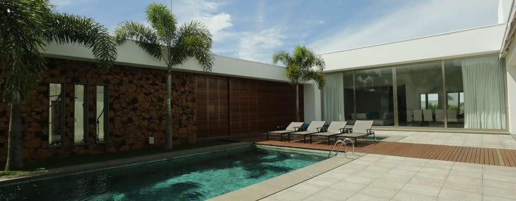 Projekty, nowoczesne Domy zaprojektowane przez R 7 Mila Ricetti Arquitetos Associados