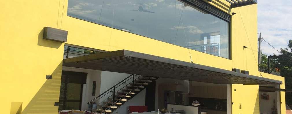 : Casas de estilo minimalista por Arquitectos y Entorno S.A.S