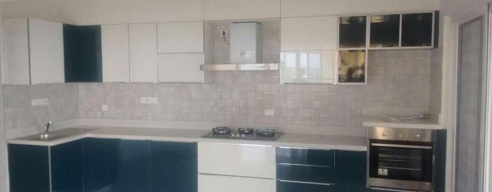 Hinged door wardrobe installed by Zenia:  Built-in kitchens by zenia