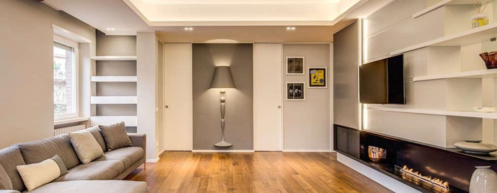 Salas de estar modernas por MOB ARCHITECTS
